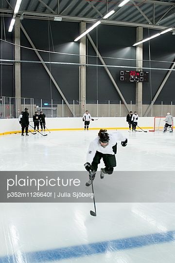 Sweden, Young hockey player skating on rink