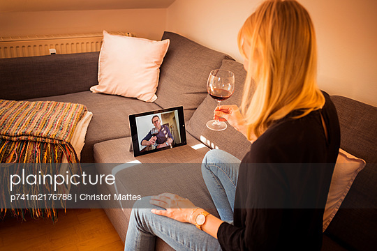 Young woman doing video chat with tablet PC - p741m2176788 by Christof Mattes