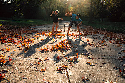 Children Playing During Autumn - p1262m1063987 by Maryanne Gobble