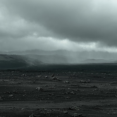 Barren landscape and dark clouds, Iceland - p1624m2195930 by Gabriela Torres Ruiz