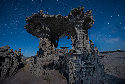 Low angle view of Tufa against star field - p1166m1526593 by Cavan Images