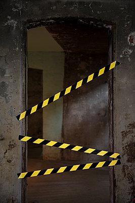 Barrier tape on open door  - p335m1041653 by Andreas Körner
