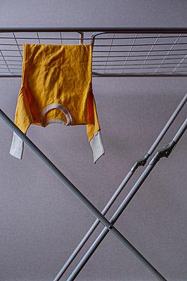 Shirt hanging on clothesline - p971m2175472 by Reilika Landen