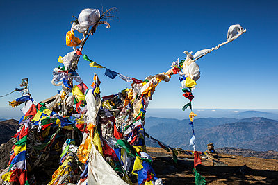 Buddhist prayer flags at the summit of Pikey Peak in the Himalayas; Nepal - p442m1580394 by Alexander Macfarlane