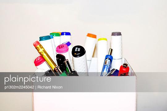 Cardboard box of pens - p1302m2245042 by Richard Nixon