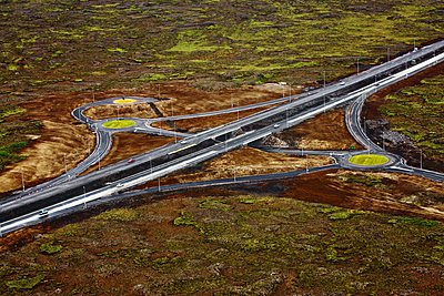 Road through volcanic landscape in Iceland - p1084m1036866 by GUSK