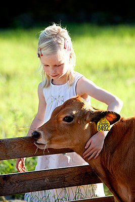 Girl together with calf - p896m834792 by Arenda Oomen