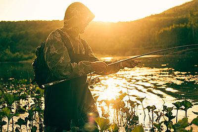 Mari man fishing in lake - p555m1415809 by Aliyev Alexei Sergeevich