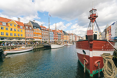 Nyhavn with old ships anchored - p1332m1528896 by Tamboly