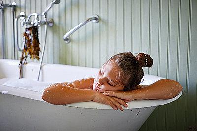 Girl relaxing in bathtub - p312m2200013 by Åsa Siller Kristensson
