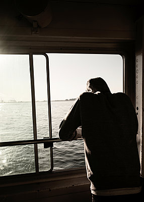 View from the ferry in the evening light - p758m2222557 by L. Ajtay