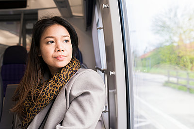 Woman travelling by train - p312m1495347 by Viktor Holm