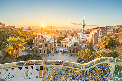 Barcelona, Catalonia, Spain, Southern Europe. Unique Antoni Gaudi's architecture of Park Guell at sunrise. - p651m2006897 by Marco Bottigelli