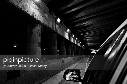 Cars driving in a tunnel in New York City - p1090m2108329 by Gavin Withey