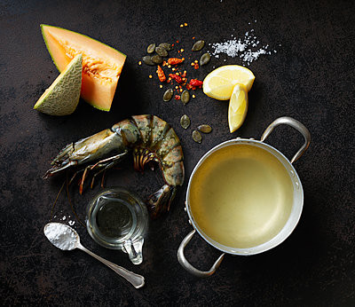 Ingredients for rockmelon soup with prawns and caramelized pumpkin seeds - p300m1587502 by Kai Schwabe