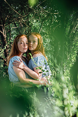 Redheaded twins at a tree - p300m2063002 by Vasily Pindyurin
