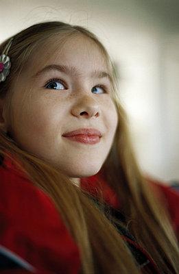 Smirking girl - p6750448 by Odilon Dimier