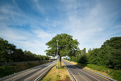 empty motorway  - p1132m1486823 by Mischa Keijser