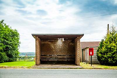 Rural bus stop shelter with a hole in the roof  - p1302m2244774 by Richard Nixon