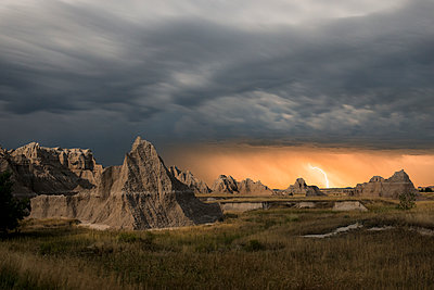 Majestic view of rock formations at Badlands National Park against thunderstorm and lightning - p1166m1509445 by Cavan Images