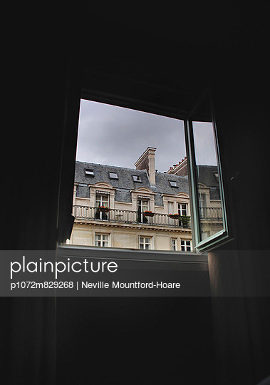 View of apartment block from hotel window in Paris - p1072m829268 by Neville Mountford-Hoare