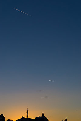 Vapour trails at sunset - p1369m2064746 by Chris Hooton