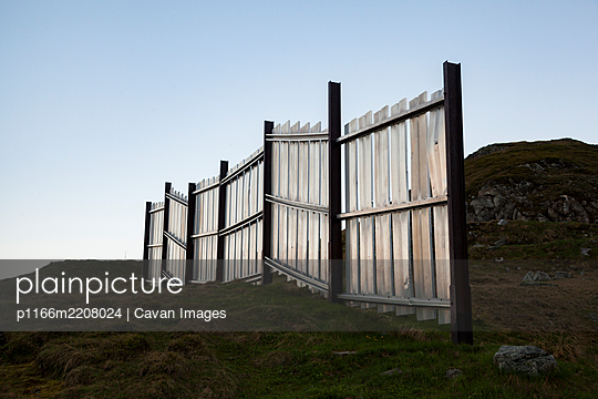 Snow fence for avalanche control above Realp, Uri, Switzerland - p1166m2208024 by Cavan Images