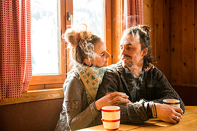 Couple in a mountain cabin - p1142m1035027 by Runar Lind