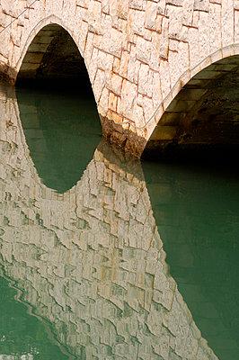 Stone bridge over water, Trogir, Dalmatian Coast, Croatia - p8552232 by Stuart Cox