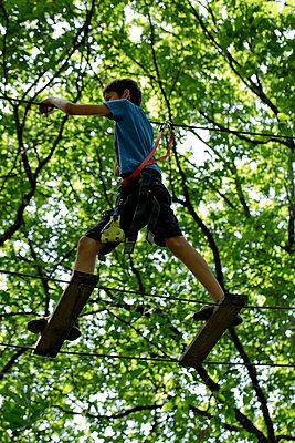 Boy on a Zip Line - p445m1055751 by Marie Docher