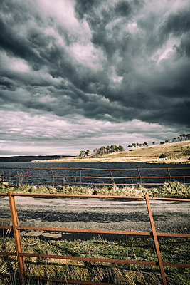 Lake landscape dramatic fence rusty old clouds - p609m1219728 by OSKARQ