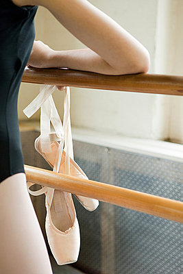 Close up on ballerina and ballet shoes - p9245546f by Image Source
