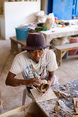 Potter in workshop working on earthenware jar - p300m1153403 by Konstantin Trubavin