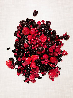 Various berries on white background - p312m1121462f by Susanne Walstrom