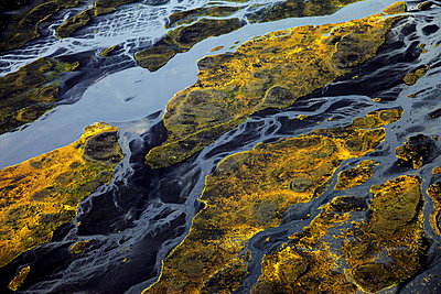 Aerial view of meandering river in moss covered landscape, Landmannalaugar,  Iceland - p1026m992063f by Romulic-Stojcic