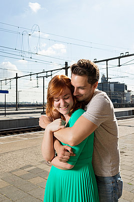 Couple at the station - p1132m1159137 by Mischa Keijser
