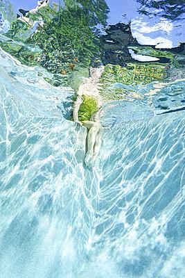 underwater ballet dancer woman  - p1554m2159062 by Tina Gutierrez