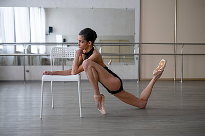 Ballerina works out in the ballet school - p1646m2288655 by Slava Chistyakov