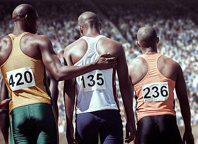 Runner comforting teammate - p1023m946891f by Tom Merton