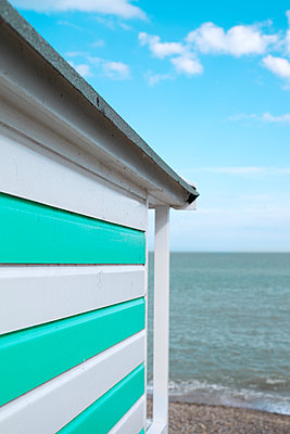 Beach hut looking out to sea - p1228m1466073 by Benjamin Harte