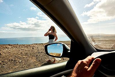 Woman phoning on beach - p890m2099720 by Mielek