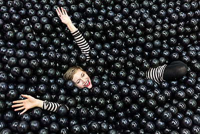 Woman in a ball pool, Liquorice pool - p1332m2055038 by Tamboly