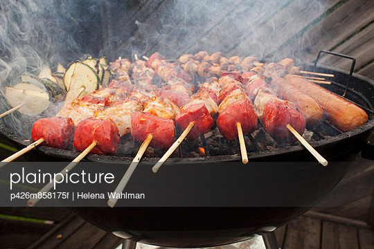 Barbecue skewers on grill - p426m858175f by Helena Wahlman