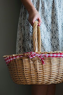 Caucasian Woman Holding Picnic Basket - p1331m1182440 by Margie Hurwich