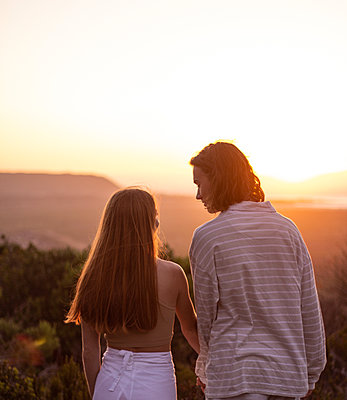 Teenage couple in love at sunset - p1640m2245874 by Holly & John