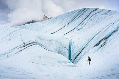 Female hiker on Root Glacier Wrangell St. Elias National Park and Preserve near McCarthy, Alaska - p343m1475642 by Cavan Images