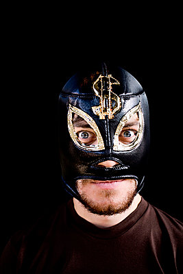Mad Man Wearing Wrestlers Mask, Staring Eyes, Studio Shot - p8473848 by Johan Strindberg