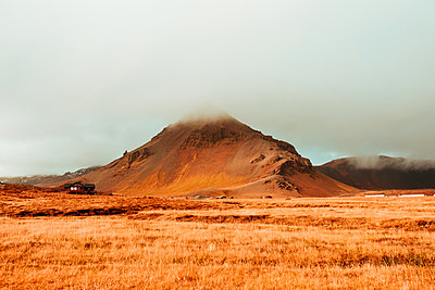 Fog over mountain top, Londrangar, Snaefellnes Westfjords, Iceland - p429m2091654 by Senserini Lucrezia