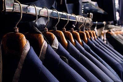 Row of blazers on rack in tailors boutique - p300m2242338 by Antonio Ovejero Diaz