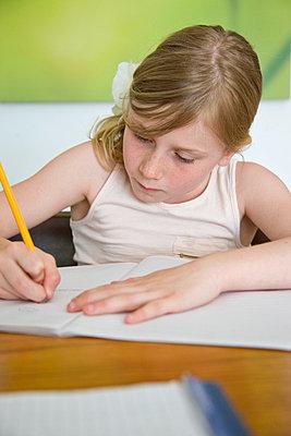 Girl Doing Homework - p6692299 by David Harrigan